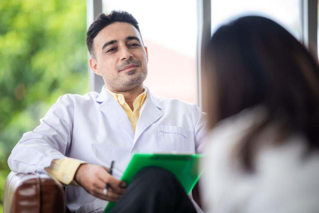 Psychologist doctor give a consult and talk to depression patient for diagnosis health.
